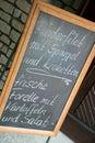 Seasonal menu on a chalkboard in german language Stock Images