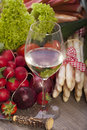 Seasonal vegetables fresh with a glass of white wine on a wooden background Royalty Free Stock Photography