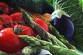 Seasonal vegetables including asparagus tomato aubergine savoy cabbage Royalty Free Stock Photo