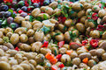 Seasoned olives salad close up view of green in a weekly sicilian market Royalty Free Stock Photo