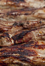 Seasoned pork chops ribs on a bbq Stock Photography