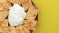 Seasoned rosemary and olive oil crackers with dip Royalty Free Stock Photo