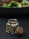 Seasoning close up view of small bottle with italian on gray background Stock Photos