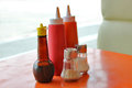 Seasoning on the table dining sauce and pepper bottle in fast food Stock Photos