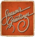 Seasons greetings hand lettered vintage card with lettering handmade calligraphy and with grunge effect Stock Photography