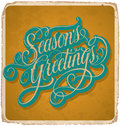Seasons greetings hand lettered vintage card with lettering handmade calligraphy and with grunge effect Royalty Free Stock Photo