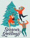 SEASONS GREETINGS. People young men and women decorate a Christmas tree. Royalty Free Stock Photo