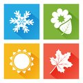 Seasons icon. Set of nature. Blue winter with snowflake, green spring with flower and leaf, yellow summer with sun, orange autumn
