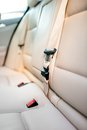Seat belt on rear seat of modern car with beige leather interior Royalty Free Stock Photo