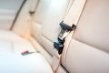 Seat belt on rear seat of modern car with beige leather Royalty Free Stock Photo