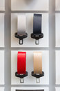 Seat belt samples of different colors at car dealership showroom Stock Photography
