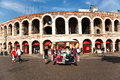 Seat cushions are sold in front verona italy august of the famous old roman arena of verona on august verona italy Stock Image