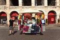 Seat cushions are sold in front verona italy august of the famous old roman arena of verona on august verona italy Stock Images