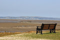 Seat on shore and view across morecambe bay from the foreshore at hest bank lancashire looking the sands of at low tide past the Royalty Free Stock Photography