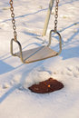 Seat of the swing inwinter with snow Royalty Free Stock Photos