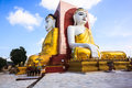 Seated buddha at kyaik pun temple in bago myanmar Royalty Free Stock Photography