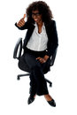 Seated woman with thumbs up gesture Stock Photography