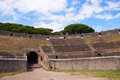 Seats in the amphitheatre of pompeii seating once buried city campania italy this is now used for large concerts Royalty Free Stock Images