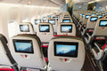 Seats on board of airplane. Economy class with screens Royalty Free Stock Photo