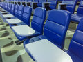 Seats in empty auditorium blue chairs Royalty Free Stock Photography