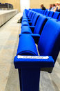 Seats reserved sign on first row of in an auditorium can also be used as metaphor symbol Royalty Free Stock Photography