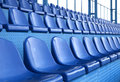 Seats at stadium empty plastic open door sports arena Stock Photos
