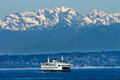 Seattle bainbridge island ferry puget sound washington car olympic snow mountains state pacific northwest Royalty Free Stock Photos