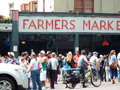 Seattle farmers market a crowd of people huddle around the bustle of the famous Royalty Free Stock Photography