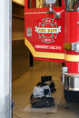 Seattle fire truck june open door of a dept with two sets of boots ready to be put on showing the department is ready at a Royalty Free Stock Photos