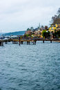 Seattle Beach Dock Puget Sound Washington State Harbor Boat Yellow Apartment Blue Water Rocks Trees Evergreen Beautiful Bay Landsc Royalty Free Stock Photo