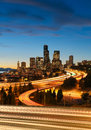 Seattle skyline at dusk with car light trails due to the long exposure Royalty Free Stock Photography