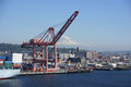 Seattle waterfront with mt rainier washington jun dockyard cranes in background puget sound pacific northwest Stock Image