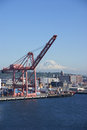 Seattle waterfront with mt rainier washington jun dockyard cranes in background puget sound pacific northwest Stock Photos