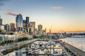 Seattle waterfront at sunset downtown and of reflection in water and ferry in background Royalty Free Stock Photo