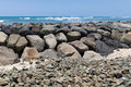 Seawall in hawaii a rock wall at sand island recreational park oahu Stock Photos