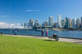 Seawall vancouver canada – april unidentified people walk on in stanley park on april is kilometre paved route that Stock Photos