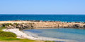 Secluded beach hillarys western australia wa january inlet and rocky groyne with indian ocean seascape in Stock Photo