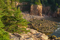 Secluded cove filled with pink granite cliffs and rocky boulders