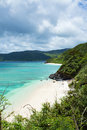 Secluded tropical paradise beach with clear blue lagoon water amami oshima island japan white sand and crystal kagoshima kyushu Stock Photography