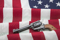 Second amendment rights revolver usa flag the old western six shooter on the american with stars and stripes depicts the concept Stock Photo