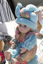 Second hand doll with sparking outfit kitsch for collection for sale at flea market Royalty Free Stock Image