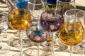 Second hand French wine glasses in different colors and shapes Royalty Free Stock Photo