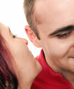 Secrecy women sharing a secret to a men focus on the ear Stock Image