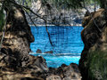 Secret beach view of the blue water through the rocks in laupahoehoe hawaii Royalty Free Stock Image