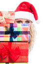 Secret christmas woman behind presents hiding many isolated on white background Royalty Free Stock Image