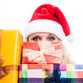 Secret christmas woman closeup of hiding behind many presents isolated on white background Royalty Free Stock Photography