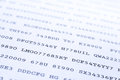 Secret codes printed on paper narrow depth of field blue toned effect Royalty Free Stock Photos
