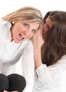 Secret among friends two young female one whispering on the other�s ear Stock Photo