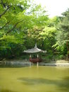 The secret garden of changdeok palace a view across pond to a resting place beneath a pagoda this is inside in south korea Stock Photos