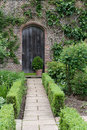 Secret garden. English garden path and door Royalty Free Stock Image